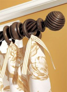 I like the ribbons tying the curtains to the rings. Nice touch and a chance to add a little unobtrusive color