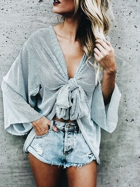 Cute striped top with distressed denim shorts.