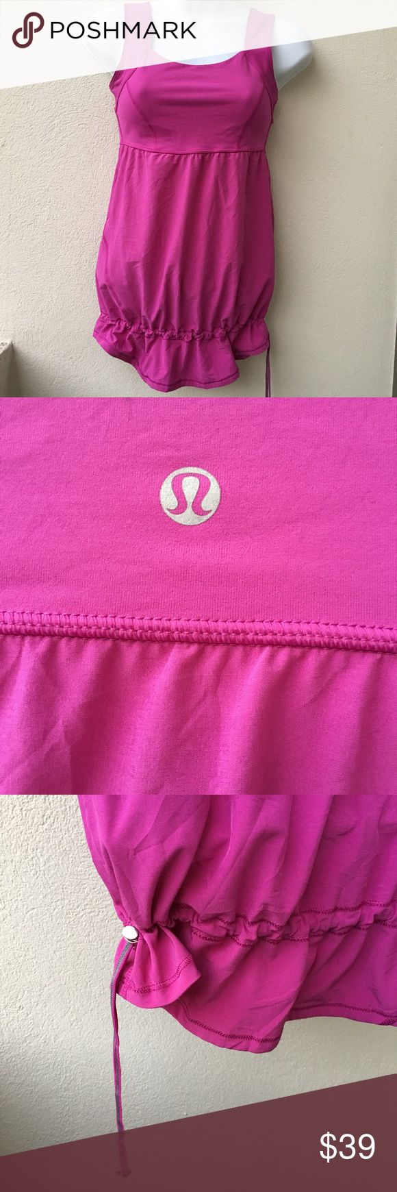 Lululemon Magenta Top size 4 Preowned lightly worn like new Lululemon Magenta Top size 4. No builtin bra. Has drawstring at the bottom to wear shirt as desired. Please look at pictures for better reference. Happy shopping!! T1 lululemon athletica Tops Tank Tops