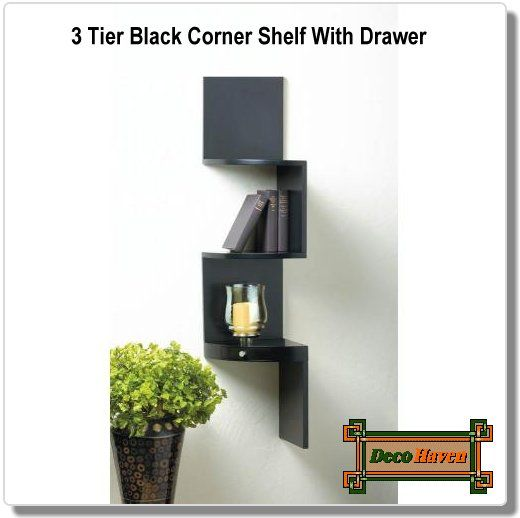 3 Tier Black Corner Shelf With Drawer - This is the coolest way to transform the corner of your room from wasted space to artistic focal point! This wooden white wall shelf features three small display shelves and the bottom features a miniature drawer. You'll love the way this functional piece of art amplifies the style in your space.