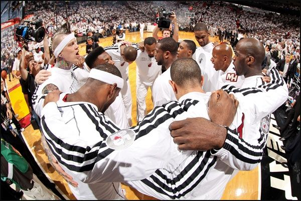 The Miami Heat players in a huddle before starting Game 7 in the finals