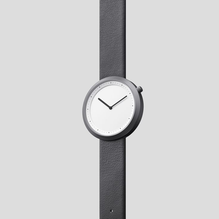 GUN-GREY STEEL ON GREY ITALIAN LEATHER   Clean, classic and contemporary, Facette pays homage to the iconic, circular watch shape while incorporating distinct, forward-thinking design details.