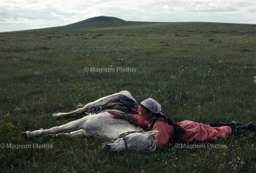 Eve Arnold CHINA. Inner Mongolia. Horse training for the militia. 1979.