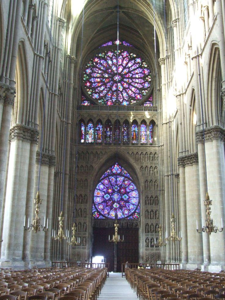 Notre-Dame de Reims Cathedral, Paris, France --- Interior --- Nave looking west showing 2-rose windows.