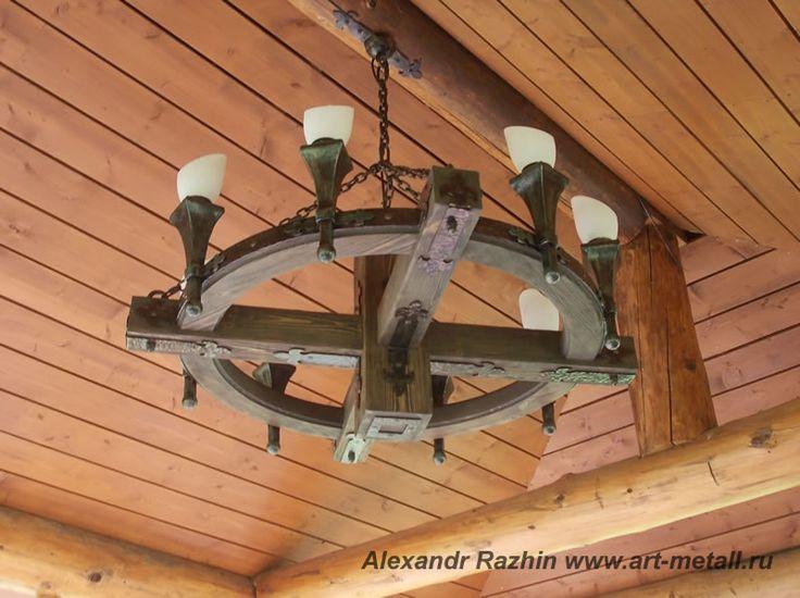 Брутальная деревянная люстра с коваными элементами в беседку , на террасу. Состаренная сосна. Диаметр 120 см. 8 светильников в виде факела. 60 т.руб.