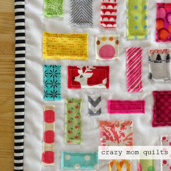 Here's scrap project #100/101! It's a little ticker tape doll quilt (tutorial here ) that I made for my daughter. I had her pick some of ...