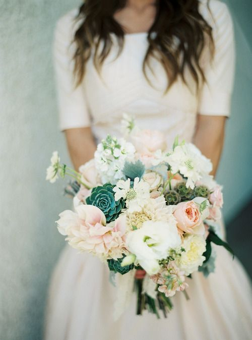 Kelly green succulents and peach roses and dahlias