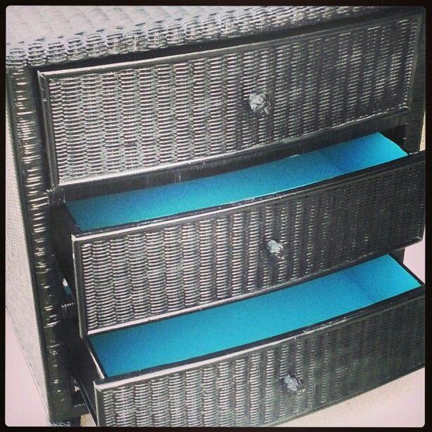 Wicker dresser spray painted black. Inside drawers painted teal.