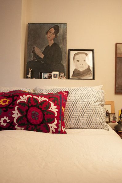 Bohemian - Artworks grouped above a bed