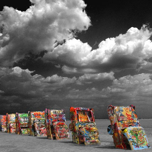 Cadillac Ranch  Route 66 just west of Amarillo, Texas .  Been there a bunch of times and painted on them too.