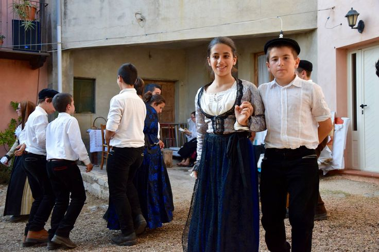 Some young boys and girls enjoying traditional Sardinian dance, Baunei, Ogliastra