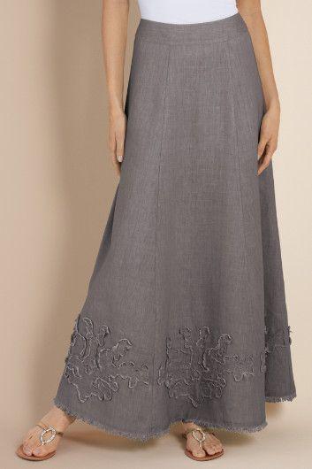 Love this linen beach skirt featuring a yoke waist w/back elastic, applique and raw hem. Easy, breezy for summer!