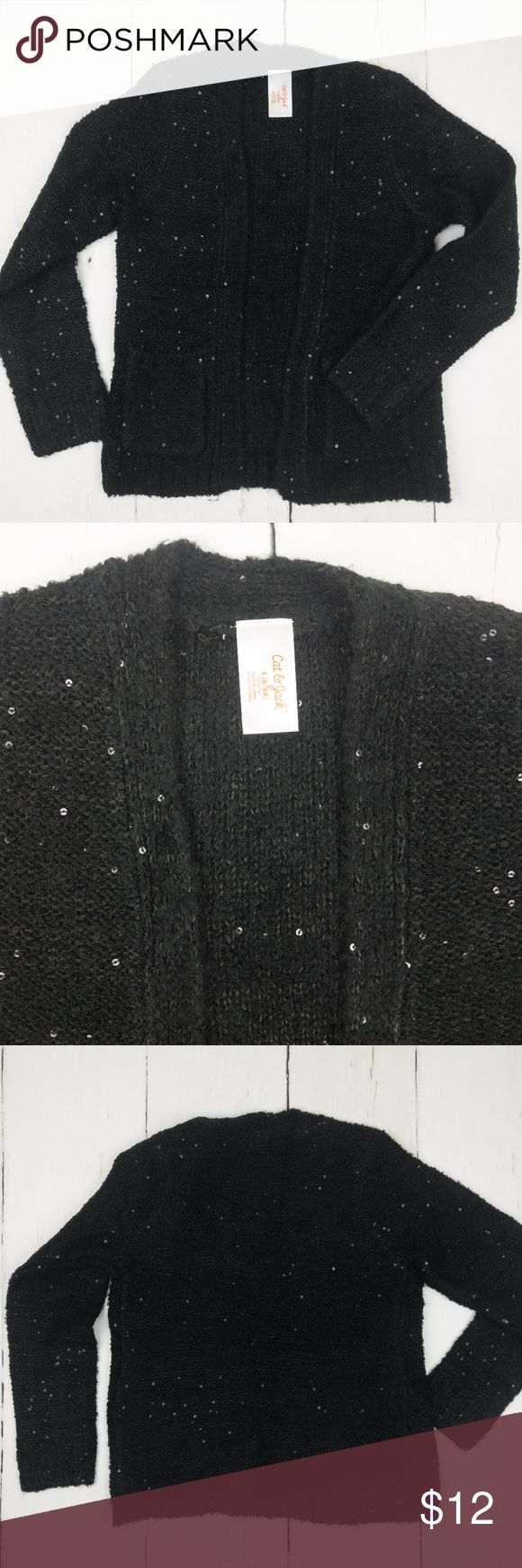 Girls Cat & Jack Black Sparkle Sweater Size 6 This black long sleeve sweater has sparkles on it and is from the Target line, Cat & Jack. It was only worn once, and has an open front with pockets. It falls to the hips and is a girls size 6/6X.  From Cat & Jack (Target brand). Girls Size 6/6X. 65% Acrylic, 35% Polyester. Cat & Jack Shirts & Tops Sweaters
