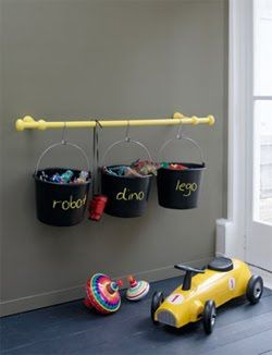 Buckets hanging from a curtain rod.....I want to do this in the playroom for crayons, pencils, markers, etc.