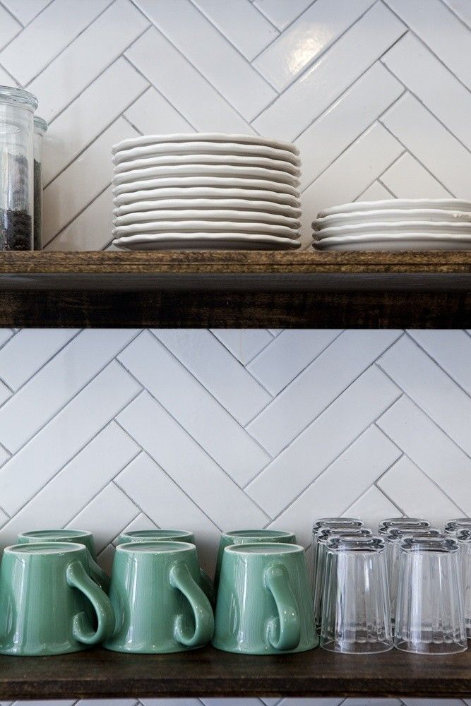 Chevron tiles with wooden shelving                                                                                                                                                      More