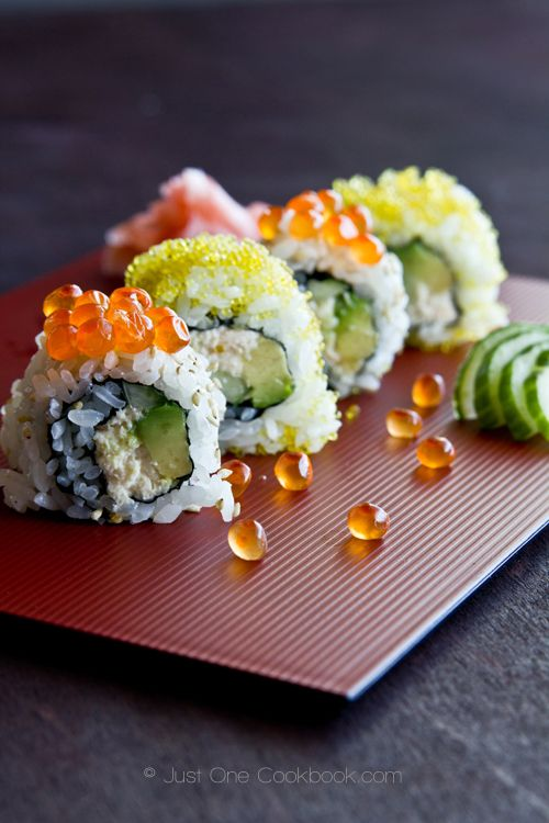 California Roll recipe - crab meat, cucumber and avocado, and the outer layer of rice is covered with toasted sesame seeds.   9 cups prepared Sushi Rice (3 cups uncooked Japanese rice)  2 (6oz/170g) cans crab meat  8 Tbsp. (½ cup) Japanese mayonnaise  ½ English cucumbers  2 avocados  ½ lemon for avocado (optional)  9 nori sheets  ¼ cup white sesame seeds