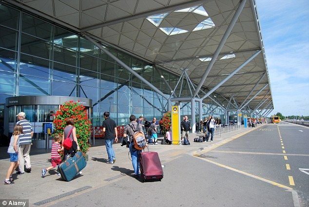 Flying into Britain: The Italy-based migrants allegedly arrived at London Stansted Airport (file picture) before going to interviews at the Jobcentre and getting National Insurance numbers for use on bogus pay slips