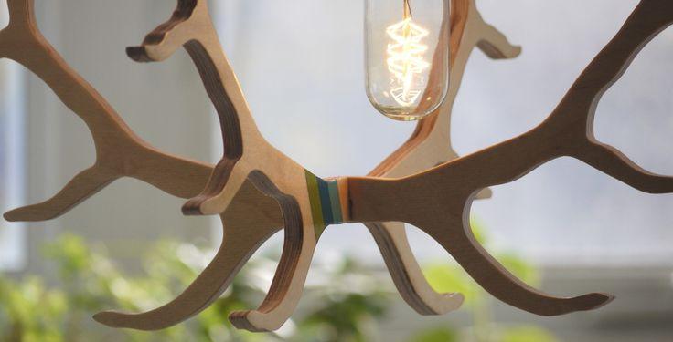 Elk antler pendant light hanger with vintage incandescent bulb. longwkd.com