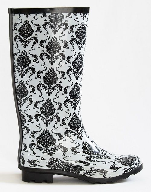 You won't blend into the background in these crisp black and white gumboots with a vintage twist. Buy these 'She's no wallflower' gumboots from www.GumbootBoutique.com