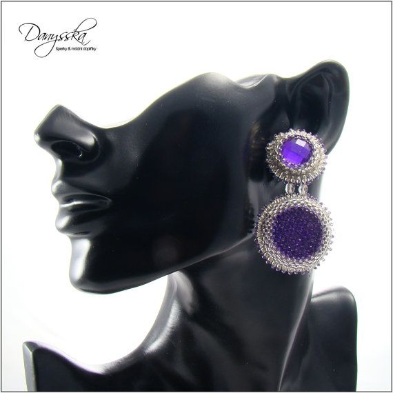 The earrings are made of czech seed beads Preciosa, japanese TOHO seed beads, firepolished beads and plastic cabochons.    They are backed with felt.    Earstud, plastic earnuts are included.    They are 6 cm (2.36 inches) long.    Specification:    - color: purple, silver  - width: 6 cm (2.36 inches)  - material: czech seed beads Preciosa, japanese TOHO seed beads, firepolished beads and plastic cabochons  - material of components: base metal    Matching bracelet…