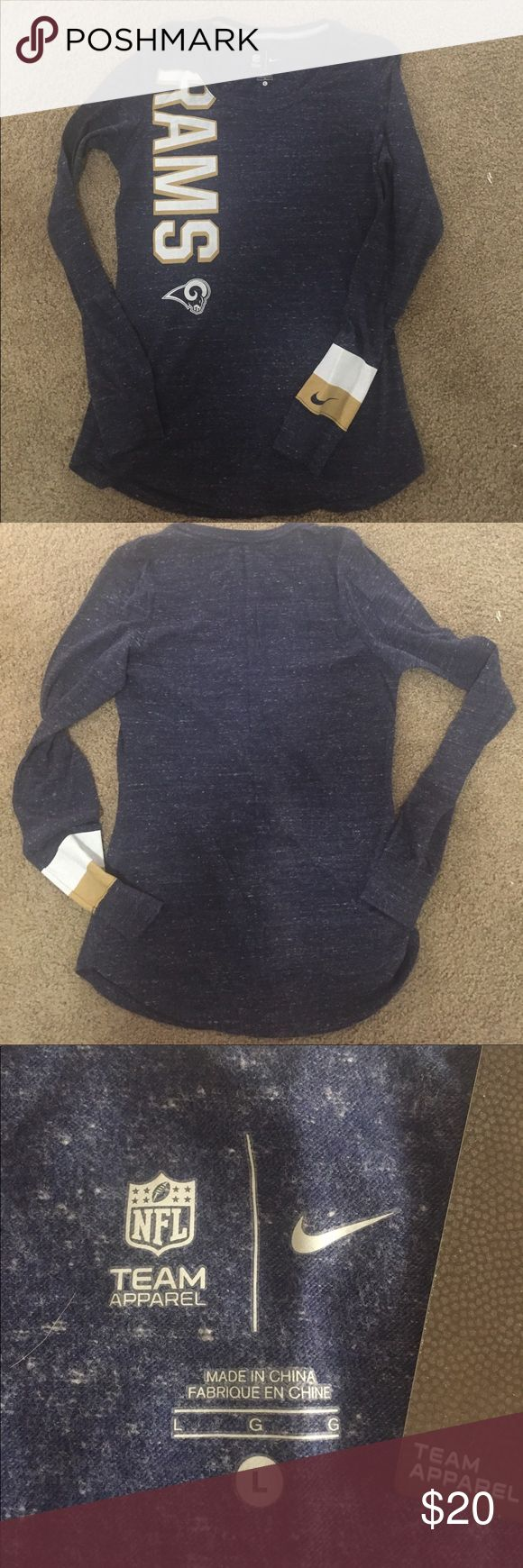 """Nike NFL Team Apparel Top New with tag. I did remove tag and wash once due to it being dropped and soiled. Los Angeles Rams Women's Large. Measures 17-1/2"""" pit to pit, and is 28-1/2"""" length. Sleeves are 23"""" from pit to end. Nike Tops Tees - Long Sleeve"""