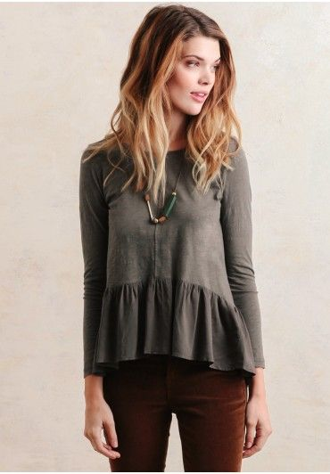 A darling and chic peplum top, complete with fitted long sleeves and a keyhole cutout located at the back. Add a romantic flair to any casual look.