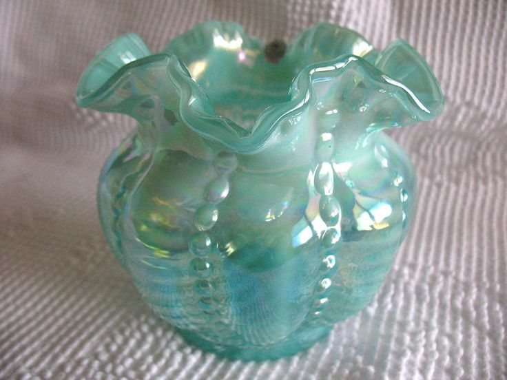 You are buying a Fenton Art Glass beaded melon vase. It is green or aqua glass with a opalescent iridescent color. It has a purple color in the iridescent. The melon part of it has smooth panels and ribbed panels. | eBay!