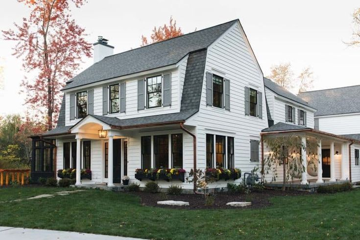 Delightful Modern Farmhouse Style Home Nestled In East Grand Rapids In 2020 Colonial House Exteriors Traditional Home Exteriors Dutch Colonial Homes