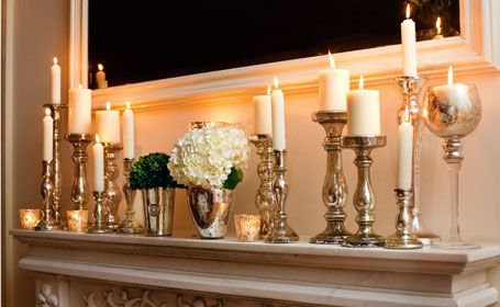 Mismatched silver candlesticks scattered around the reception help give a warm glow and have some serious vintage appeal.