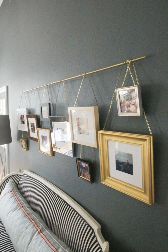 easy DIY picture rail using brass cafe curtain rod and plumber's chains Do this with the plumbing pipe and frames in the laundry room.