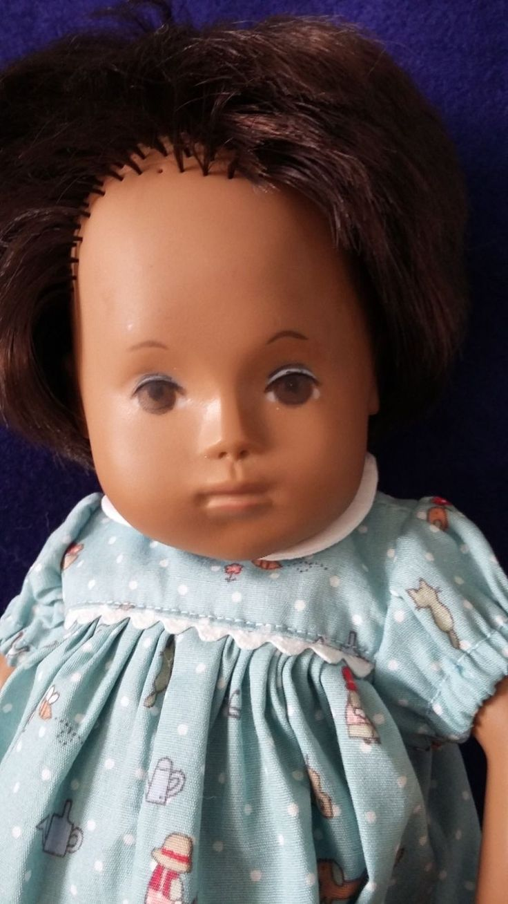 Stringing slightly loose, bit doll sits ok. She needs a