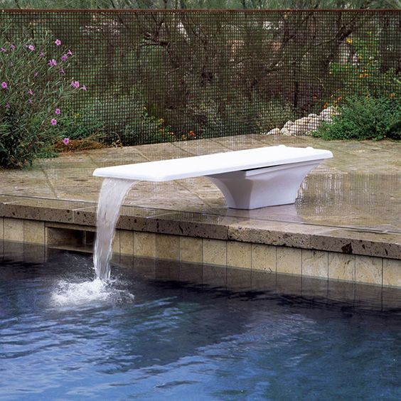 While a number of homeowners' associations and insurance companies prohibit high dives, you can still install a diving board on the edge of your pool. Of course, opting for something that is rich in design can make it less of an eyesore, so consider a nontraditional diving board, perhaps with a waterfall that keeps it feeling a bit more natural in your pool space.