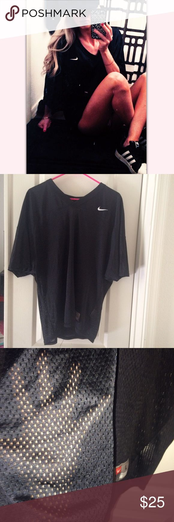 Nike original mesh Jersey shirt Nike original black mesh jersey shirt. Kids large. Cute for over bikini or out and about running errands. New with tags perfect condition Nike Tops Tees - Short Sleeve