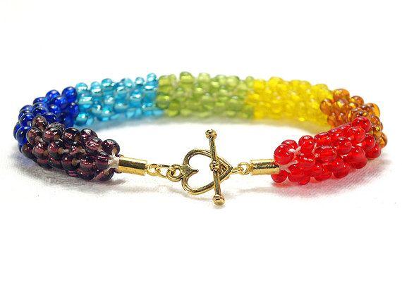 Rainbow beaded Kumihimo bracelet with gold-plated heart toggle clasp by FfigysDesigns #Cavetsy #Etsy #KumihimoBracelet #Jewelry #Handmade