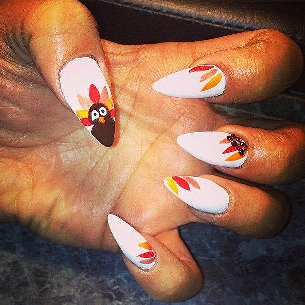 These fierce stiletto nails get a fun makeover thanks to our feathered friend.