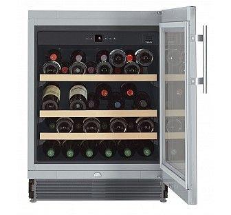 Liebherr. Cave à vin. Cette cave de vieillissement encastrable sous plan inox vitrée traitée anti-UV, permet de stocker 46 bouteilles type Bordeaux. Equipée de 3 clayettes, d'un affichage digital, d'une serrure et remplit tous les critères de conservation du vin à long terme. UWKes 1752