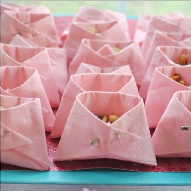 Pink organsa bags with chocolates in