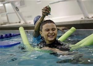 A boy attends a swim lesson in New York April 15, 2015, as part of a program sponsored by Autism Speaks.