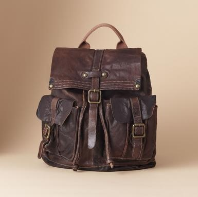 """Vegetable tanned leather, washed to vintage softness, shapes a handsome traveler. Under the buckled, magnetic flap, the drawstring top opens to a roomy, lined interior with zip and phone pockets. Outside, two buckled, magnetic pouch pockets keep things handy. Top carry handle, adjustable webbing shoulder straps. Imported. 13""""W x 6""""D x 15""""H."""
