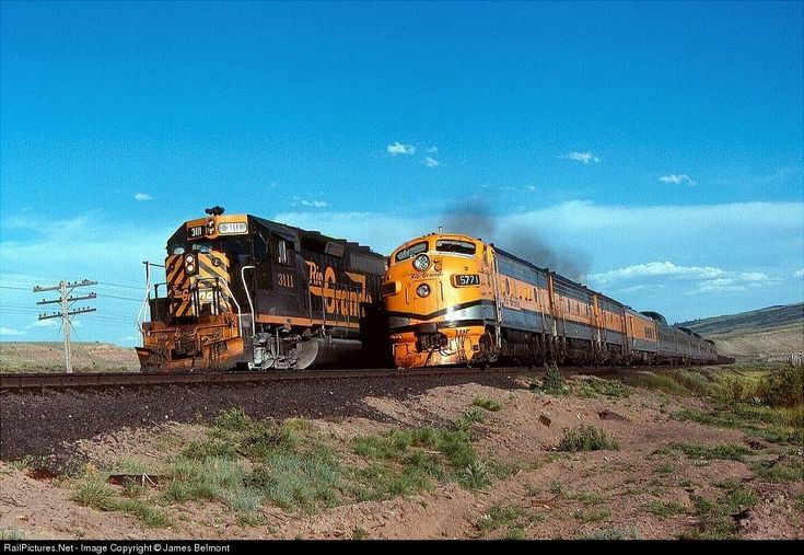 The Rio Grande Zephyr passes a waiting coal drag at Colton Junction, Utah, 1978, by James Belmont