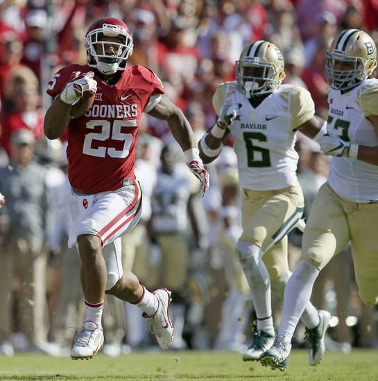Oklahoma's Joe Mixon (25) runs past Baylor's Henry Black (6) and Baylor's Greg Roberts (52) on his way to the end zone for a touchdown during a college football game between the University of Oklahoma Sooners (OU) and the Baylor Bears (BU) at Gaylord Family-Oklahoma Memorial Stadium in Norman, Okla., Saturday, Nov. 12, 2016. Oklahoma won 45-24. Photo by Bryan Terry, The Oklahoman