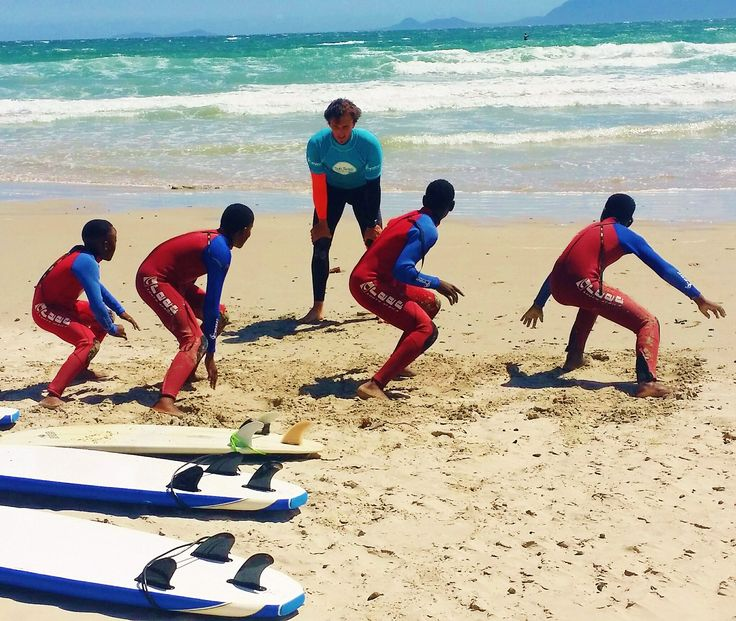 Volunteering in Cape Town means lots of opportunities to hit some waves and teach the local kids how to surf!