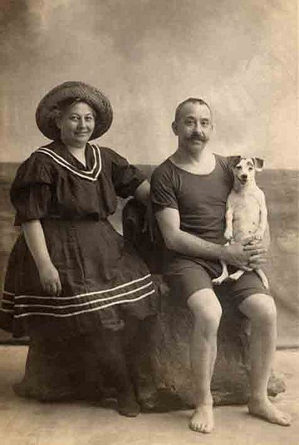 1900 man and woman at the beach with their dog