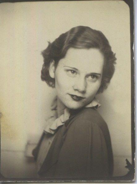Vintage photo booth portrait. SENTIMENTAL WOMAN.