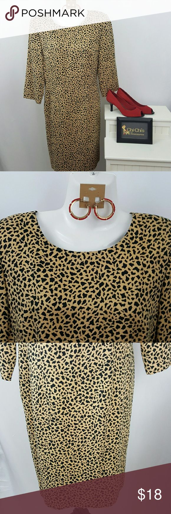 """Animal print dress size 10 petite. Animal print dress size 10 petite by Donna Morgan. Bust 18"""", Sleeve 17 3/4"""", length 36"""". 100% polyester. Zips in the back. Earrings and shoes sold separately. Donna Morgan Dresses Long Sleeve"""