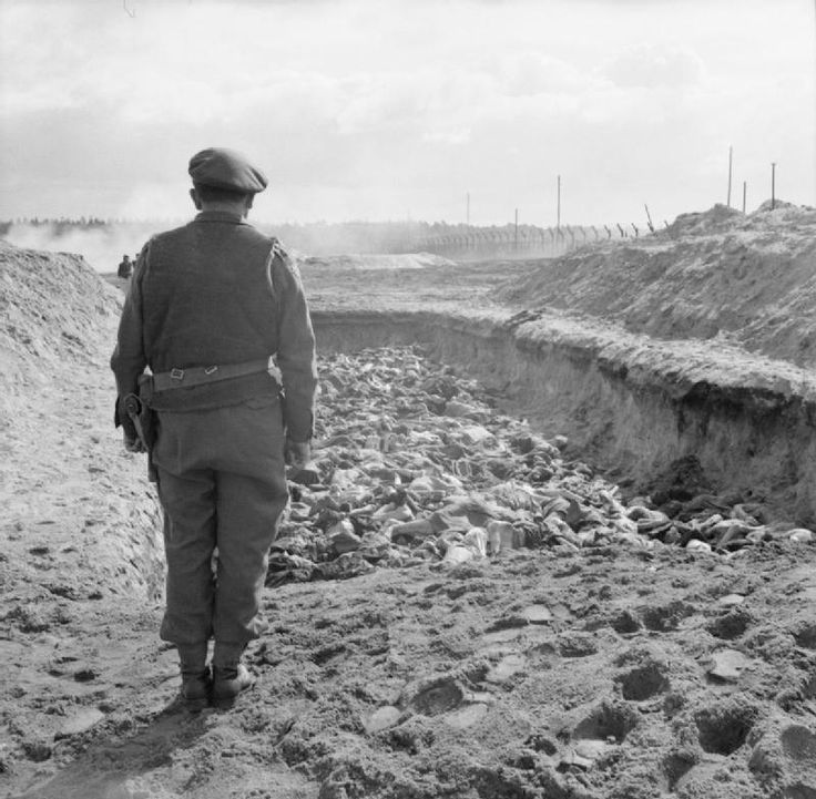 THE LIBERATION OF BERGEN-BELSEN CONCENTRATION CAMP, APRIL 1945  ~  A British Army chaplain holds a service over a massed grave before it is filled in.
