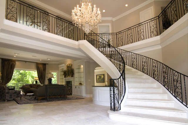 Travertine Sweeping Staircase Graces 2 Story Entry Walk