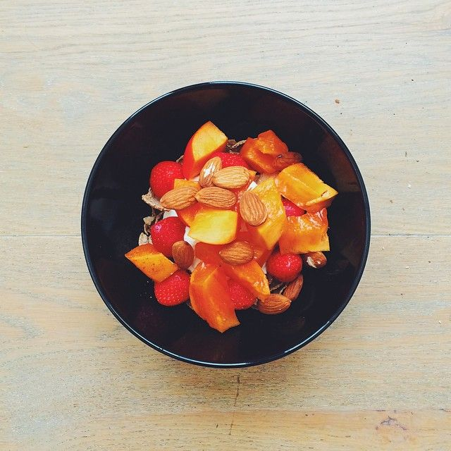Breakfast fruit salads. Persimmon week: Persimmon, strawberries, yogurt, gluten free cereal flakes, almonds. #instafood #instasalad #feelgood #healthy #healthyfood #saladpride #saladlove #saladjam...
