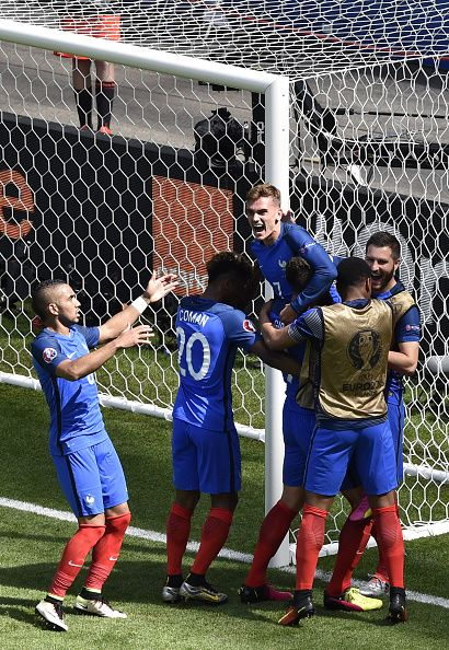 #EURO2016 France's forward Antoine Griezmann celebrates scoring a second goal with team mates during the Euro 2016 round of 16 football match between France...