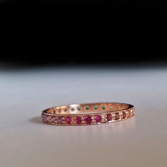 A Rose gold eternity Ring Beautifully Hand made Gold Eternity ring featuring these gem stones in actual order: Thin Rose gold Band set with beautiful gem stones creating a stunning color transition reminiscent of a rainbow. This ring has tons of presence and style, Colorful elegance simplified